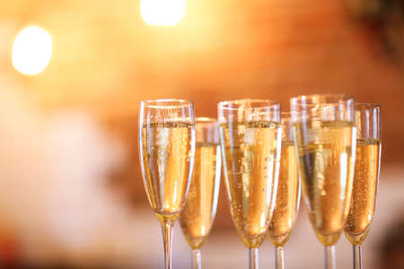 Photo for Champagne glasses on gold background. Party and holiday celebration concept - Royalty Free Image
