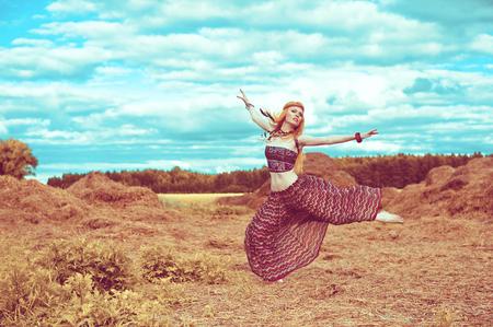 Foto de Hippie blonde girl cheerful, peaceful and free. Summer time - Imagen libre de derechos