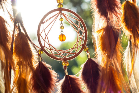 Foto de Dream catcher with feathers threads and beads rope hanging. Dreamcatcher handmade - Imagen libre de derechos
