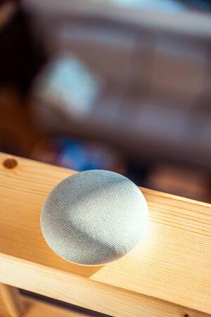 Foto de voice controlled smart speaker in a interior home environment. Smart AI speaker concept - Imagen libre de derechos