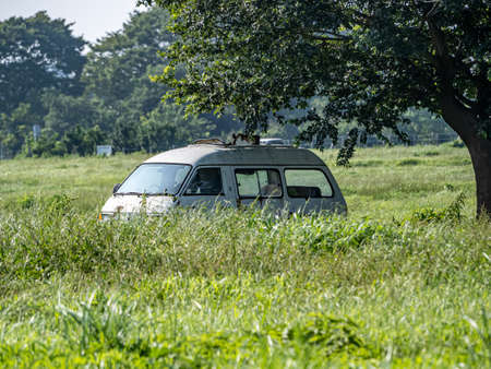 Photo pour An abandoned old van rusts in a field in the former U.S. Navy Kamiseya housing area. Recently returned to the city of Yokohama, this land is now commonly used by local farmers. - image libre de droit