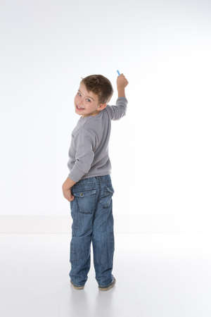 Photo for child turns back while writing on a wall - Royalty Free Image