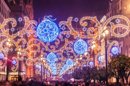 Foto de Night view of the main avenue of Seville illuminated with lights for Christmas - Imagen libre de derechos
