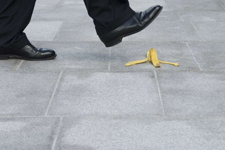 Photo for Businessman about to step on a banana skin - Royalty Free Image