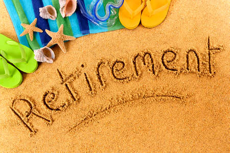 Foto de Beach background with towel and flip flops and the word Retirement written in sand. - Imagen libre de derechos