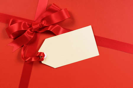 Photo for Red gift ribbon and bow with blank tag or label - Royalty Free Image