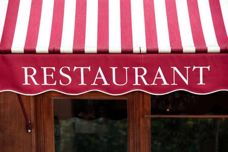Photo pour Striped french restaurant canopy in Paris france. - image libre de droit