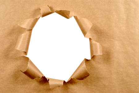 Photo for Brown craft paper background with untidy torn hole, white copy space - Royalty Free Image