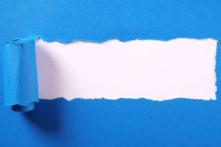 Photo for Torn blue paper strip curled edge border white background - Royalty Free Image