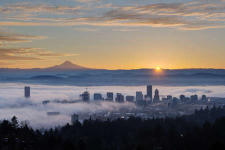 Photo for Sunrise over City of Portland Oregon and Mount Hood Covered in Low Fog Banks - Royalty Free Image