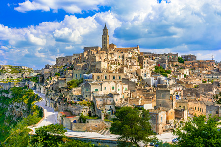 Foto de Matera, Basilicata, Italy: Landscape view of the old town - Sassi di Matera, European Capital of Culture, at dawn - Imagen libre de derechos