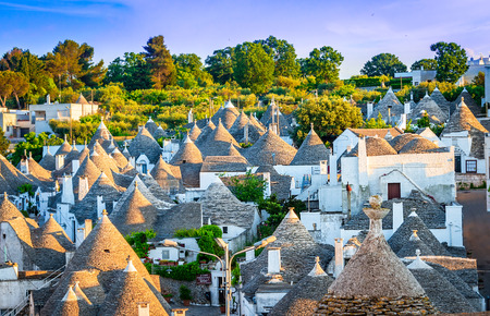 Photo for Alberobello, Puglia, Italy: Cityscape over the traditional roofs of the Trulli, original and old houses of this region, Apulia - Royalty Free Image