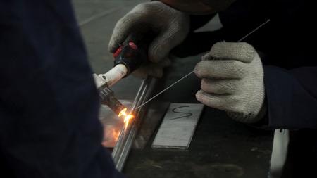 Foto de Welders working at the factory made metal. Clip. Welding at the factory. - Imagen libre de derechos