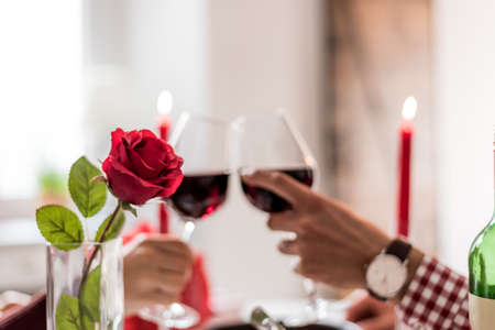 Photo for couple toasting with wine in a romantic dinner at home - Royalty Free Image