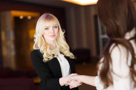 Photo for Two Businesswomen Shaking Hands In Modern Office. - Royalty Free Image