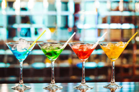 Photo for Multicolored cocktails at the bar. bartender show - Royalty Free Image