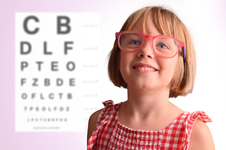 Photo for Child eye check with girl with glasses and letter board in the background. Concept of eye revision. Horizontal composition - Royalty Free Image