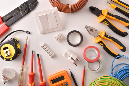 Photo for Tools and electrical material on a white table general view Horizontal composition. Top view. - Royalty Free Image