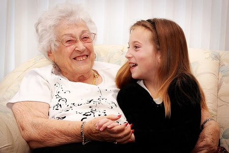 senior woman and grandchild laughing and visiting