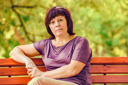 Photo for middle-aged brunette woman in a park on vacation - Royalty Free Image
