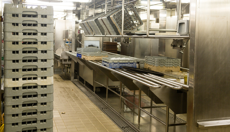 Photo for Modern stainless steel dishwashing equipment in a commercial kitchen - Royalty Free Image