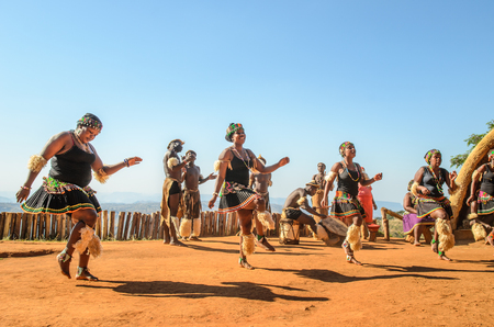 Photo for Zulu cultural experience, dressed in traditional gearZulu dressed in traditional gear dancing. Valley of a Thousand Hills, South Africa - Royalty Free Image