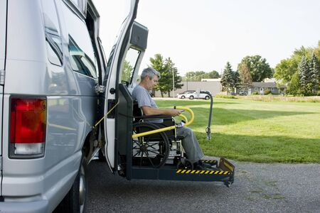 disability conversion lift van with a man in a wheelchair on the gate