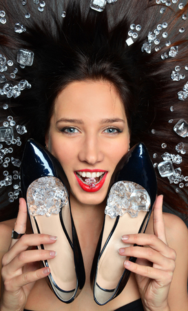 Photo for Beauty Fashion Glamour Girl Portrait. Portrait of a luxurious brunette girl lies in a placer of diamonds jewelry, luxury accessories - Royalty Free Image