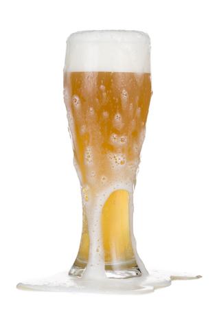 Photo pour Closeup of overflowing glass cup of beer. - image libre de droit