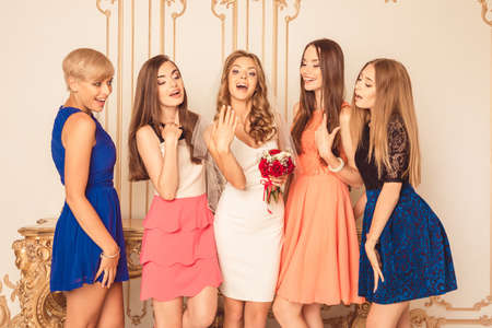 Photo for Bride showing off her ring to her friends - Royalty Free Image