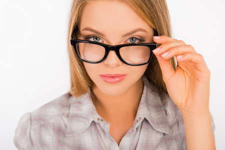 sexy young woman holding her glasses