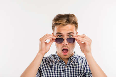 Photo for surprised man putting off his glasses - Royalty Free Image