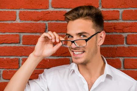 Photo pour subtle handsome man holding his glasses - image libre de droit