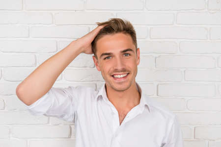 Photo for young man showing his healthy hair and smiling - Royalty Free Image