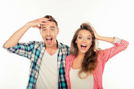 Photo for Pretty funny cheerful couple  showing surprise - Royalty Free Image