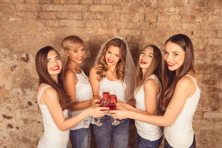 Photo for Pretty young women have party with stemware - Royalty Free Image