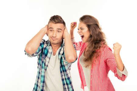 Foto de Calm young man ignore his angry girlfriend - Imagen libre de derechos