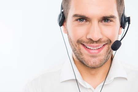 Photo pour A close-up photo of smiling young agent of call centre - image libre de droit
