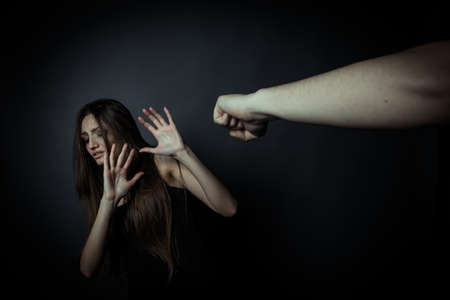 Photo for Girl trying to escape from domestic violence - Royalty Free Image