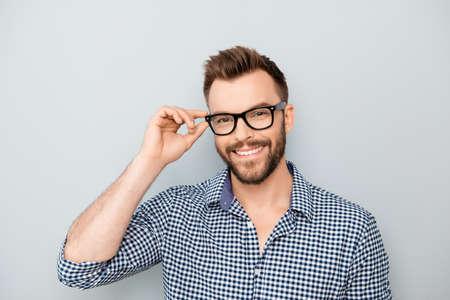 Photo pour Cheerful smiling young businessman touching his glasses - image libre de droit
