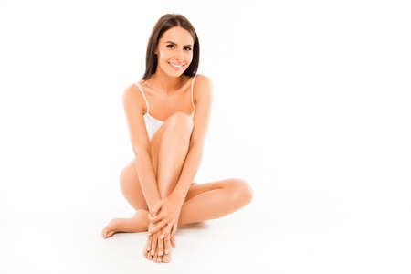 Photo pour Pretty happy sexy woman demonstrating her legs with smooth skin - image libre de droit