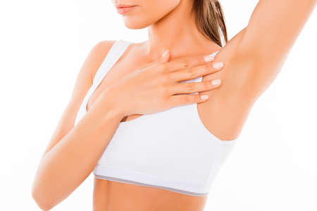 Foto de Close up of young woman showing her smooth armpit - Imagen libre de derechos