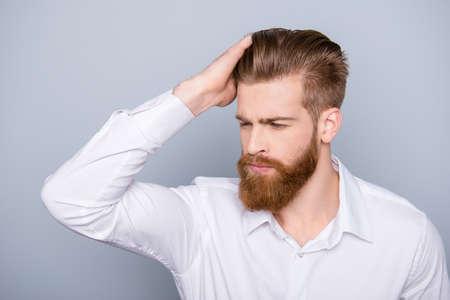 Photo pour Portrait of confident man with red beard touching his hair - image libre de droit