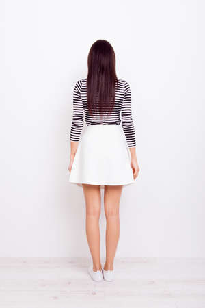 Photo for Back view full portrait of brunette woman in casual outfit on pure white background - Royalty Free Image