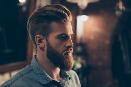 Photo pour Barbershop concept. Profile side portrait of attractive severe brutal red bearded young guy. He has a perfect hairstyle, modern stylish haircut - image libre de droit