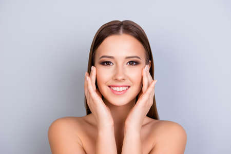 Photo pour Beauty and health concept. Young attractive girl is touching gently her attractive healthy smooth skin, looking straight in the camera. So fresh, attractive and healthy - image libre de droit