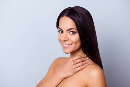 Photo pour Beauty and health concept. Cose up cropped photo of pretty young latin american woman touching her skin and look so fresh, healthy and attractive - image libre de droit