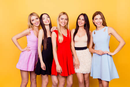 Foto de Five cute ladies in colorful short cocktail dresses are ready for night out party - Imagen libre de derechos