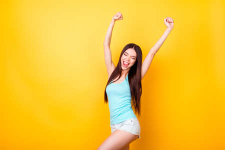 Photo pour Funky young korean lady is jumping up, wearing casual clothes, raised hands. Happiness, dream, fun, joy, freedom concept - image libre de droit