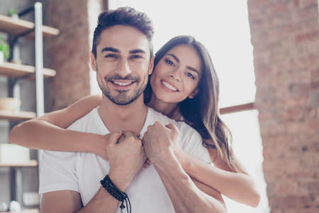 Foto de True love. Beautiful latino mulatto couple of young lovers are hugging indoors at home, with love and tenderness, wearing casual clothes - Imagen libre de derechos